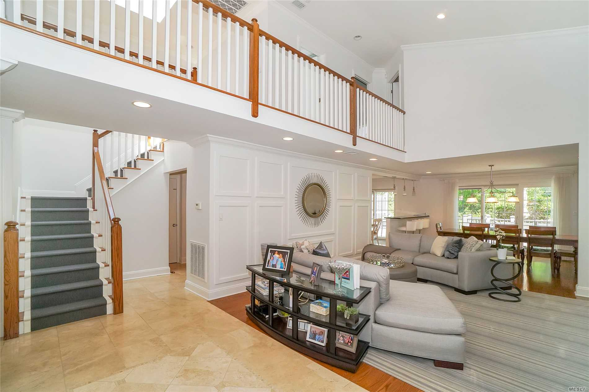 Designer Showcase Redone by Stu Senter with new windows and doors, opened Kitchen, main floor Family Room, Gracious Cathedral Ceiling Living Room , Formal Dining Room,  Luxurious Master Suite with 2 walk-in closets and over sized custom bath, two additional bedrooms and custom bath with wood floors throughout. The lower level is finished with a Playroom plus two additional rooms and Bath. Outside to a private rear deck and the front over looks a Pond!