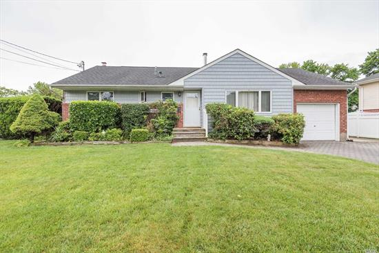 1280 Sq ft rach w/ open layout, private fenced yard. Mid block loc in quiet neighborhood w great Pkwy access. Award winning Commack schools. Tax Grievance filed. est 1700-2100 reduction
