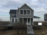 Authentic Beach House. Property Lease Long Term with Town of Babylon, Expires on 2050. Room for the Entire Family. Gorgeous Views, Summer Only House, Easy Convert to Year Round.