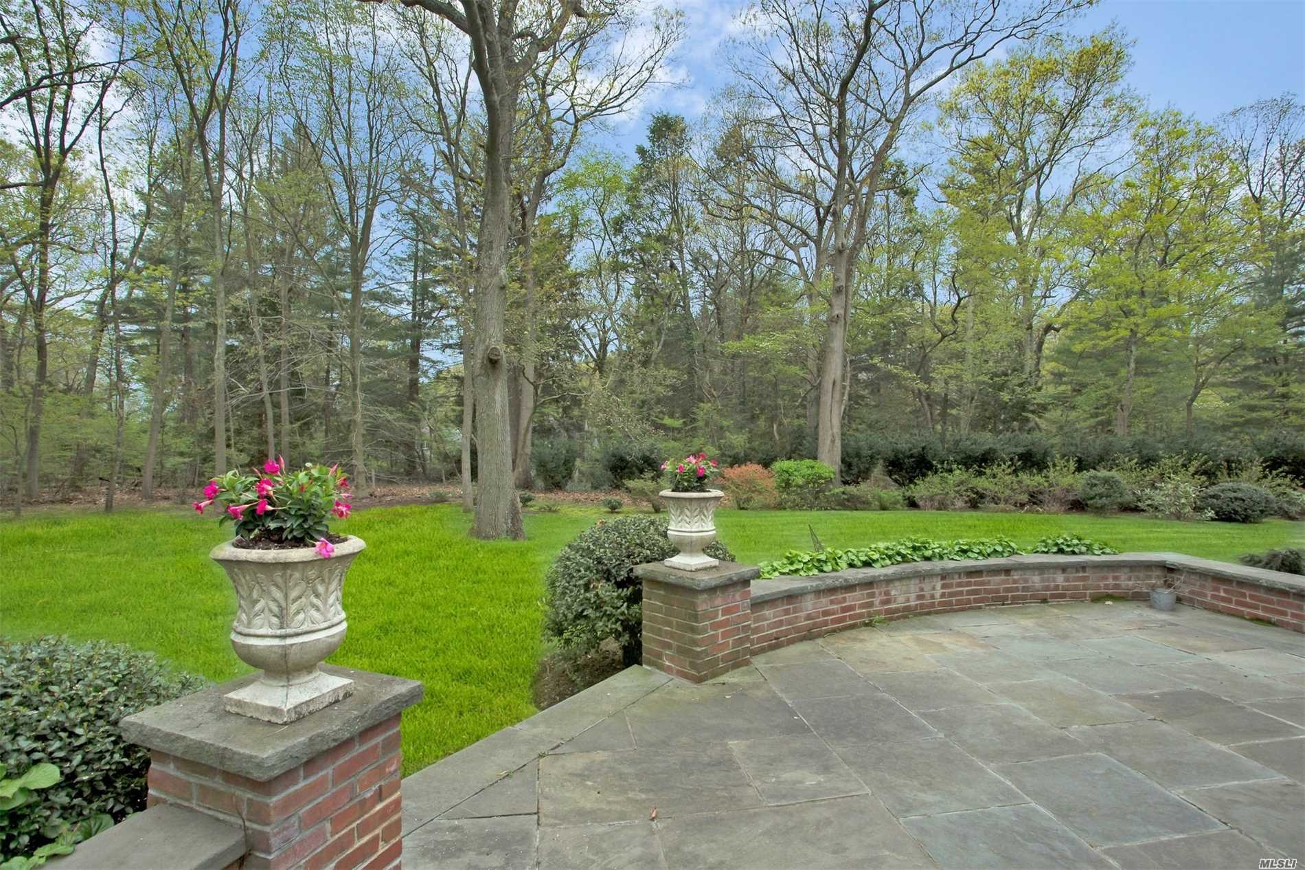 Updated 6 bedroom home situated on 4 park like acres down a private road abutting a private country club. Open entertaining flow with large living/dining room and EIK. 3 bedrooms on the first floor. Large Master suite and 2 additional bedrooms on 2nd floor along with laundry. Finished basement. Perfect for today's lifestyle
