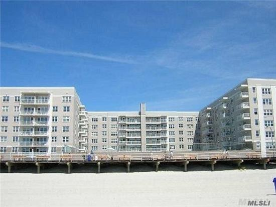 Unique! Oceanfront! Covered Parking Space! Double Terrace! Spectacular Oceanfront Spacious Jumbo Jr 4 converted to 2 Bedroom plus an Office/Den or 3rd bedroom! Open Floor Plan with updated kitchen & bath - South and North Exposure. Luxury bldg with state of the art Gym, pool, security system, direct access to boardwalk & beach, party room, library, Storage and Bike rooms, FIOS and Cablevision. 2 W/D on every floor, newly renovated lobby and Hallways. Close to Restaurants, shops, LIRR & parkways