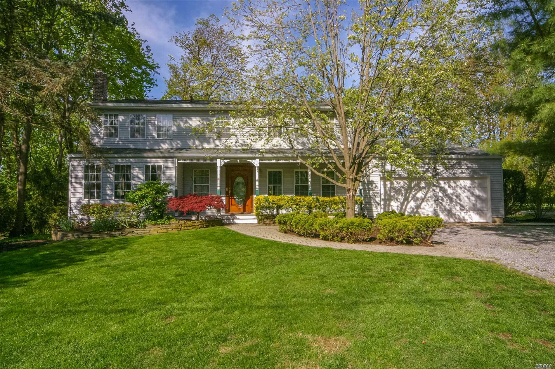 Follow Your Heart Home! Majestic 5-BD, 3-BA Colonial on 1/3-Acre. Warm & inviting home w/spacious rms, wood flrs & upd windows. Sun drenched EIK w/gas cooking & French drs to deck. Family Rm w/stone fpl & skylights. 1st Floor AuPair room/Laundry. Mstr Bdrm w/full bth & WIC. Part finished basement w/sliders to yard. Private, Fenced yard w/large deck (1-Yr old) & brick patio. Gas/HW heat. Taxes being grieved. Be the proud owner of this gracious home situated at the gateway to Huntington Bay.