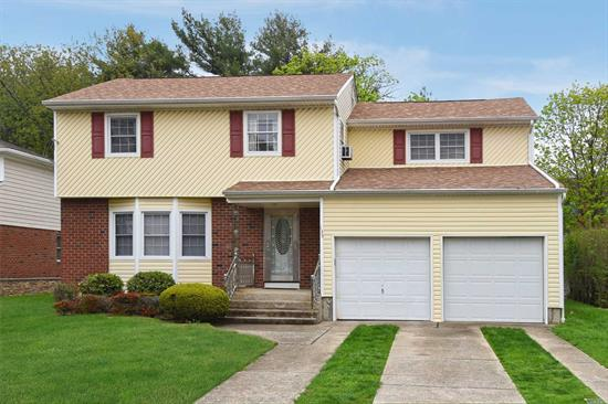 Spacious South RVC, 4 Bedroom, 2.5 Bathroom Colonial In The Heart Of the Village. Open Concept Living Rm/Dining Room & Updated Eat-In Kitchen w/High End Stainless Steel Appliances, Powder Rm, Laundry Rm & Family Rm with Entrance to Patio w/Awning & Spacious Backyard. Large Master Ensuite w/Walk-In Closet, 3 Additional Large Bedrooms & Full Bathrm. 4 Ductless AC Units, New Roof, Garage Door and Vinyl Siding. Large Unfinished Basement w/High Ceilings and Great Potential. Close to LIRR