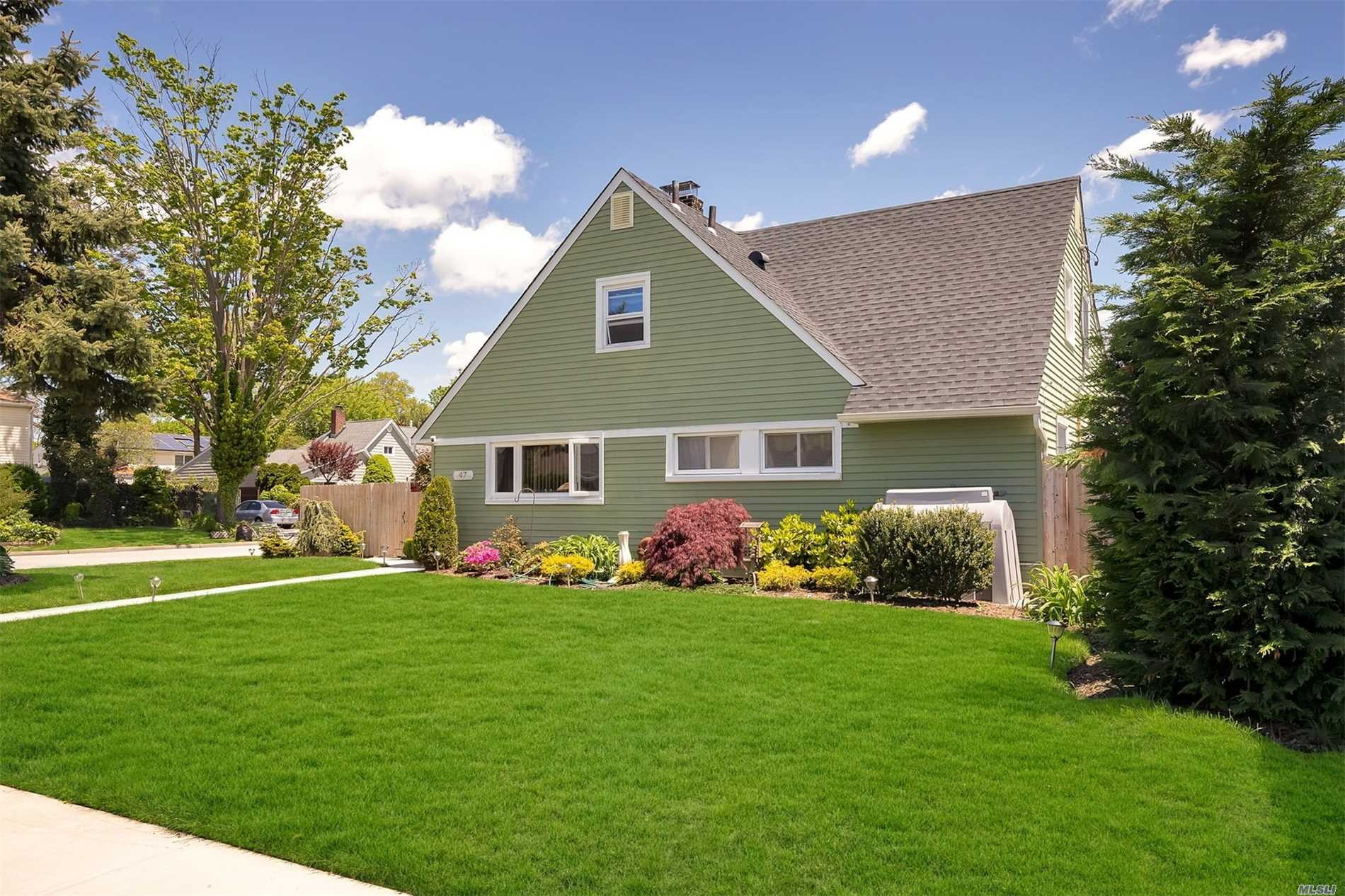 Expanded Levit Cape on Lovely Landscaped Corner Lot. Home is expanded across the rear with beautiful Open Layout. Extra Room downstairs can be a den or 5th bedroom. Fenced in Entertainers Backyard. In-ground Sprinklers. Architectural Roof 3 years old. Island Trees School District! Walk to Elementary. Big Family? YES! Low Taxes? YES!! Move right in turnkey day one! Mint Condition Many updates. Gated Driveway at rear of property..Dog Run, Gazebo, Custom Double Chair Swing and Shed a gift! Enjoy!