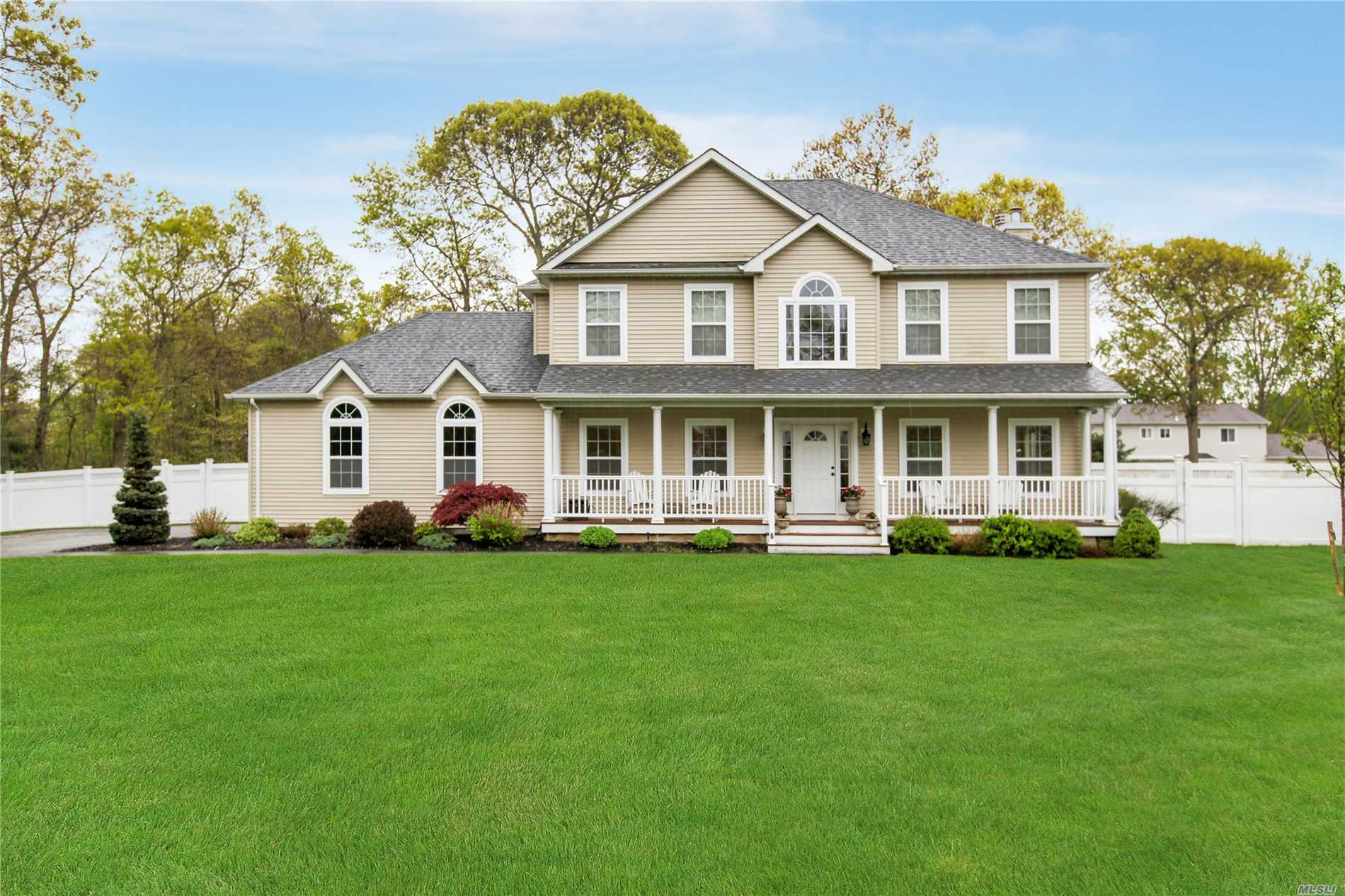 Newer Colonial with many quality upgrades. Gourmet Granite Kitchen with Center Island, Hardwood Flooring,  Fireplace, Crown Moldings, Arched entry to Family room, Stainless Appliances, Finished Basement, Private PVC Fenced, Private shy acre property Located on a Cul-De-Sac. Room for Mom!