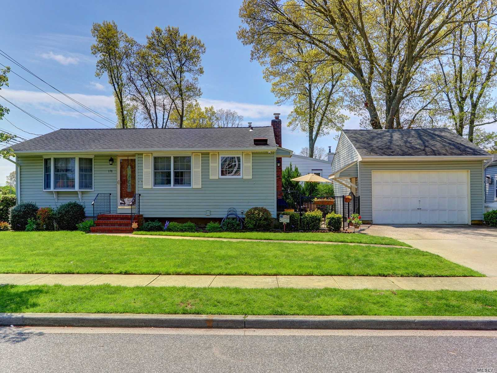 Nicely updated ranch in the Inc. Village. Hardwood floors throughout, newer baths, updated kitchen, Full basement with outside entrance. Detached 2.5 car oversized garage. Newer windows, siding, and roof. Central Air and in-ground sprinklers.  Fantastic opportunity. Prof photos coming.