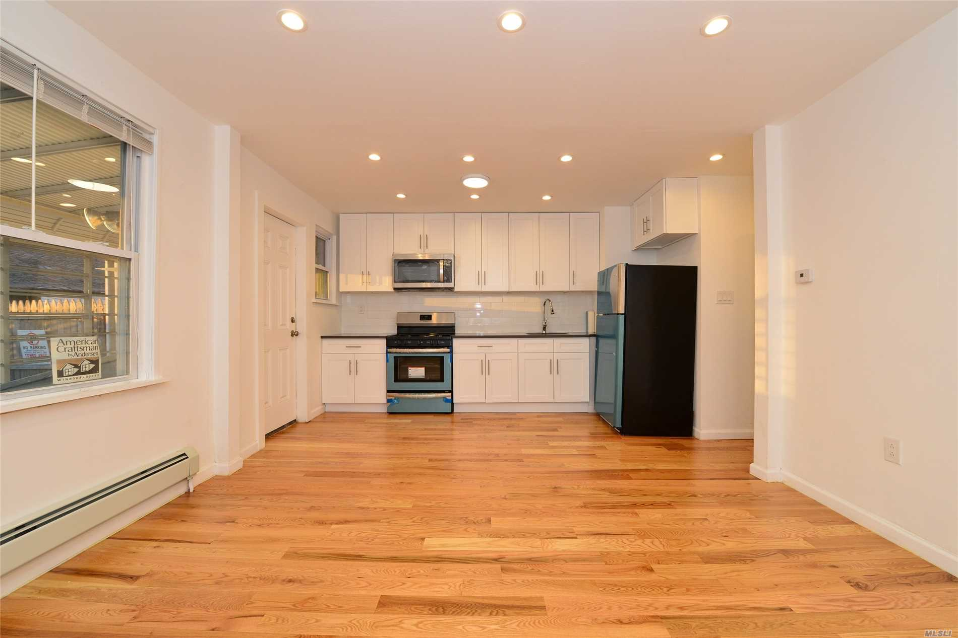Fully Renovated Large 2 Family House in Prime Location.. All New: Plumbing, Electric, Floors, Kitchens, Bathrooms, Etc. Private Backyard. Must See to Appreciate.