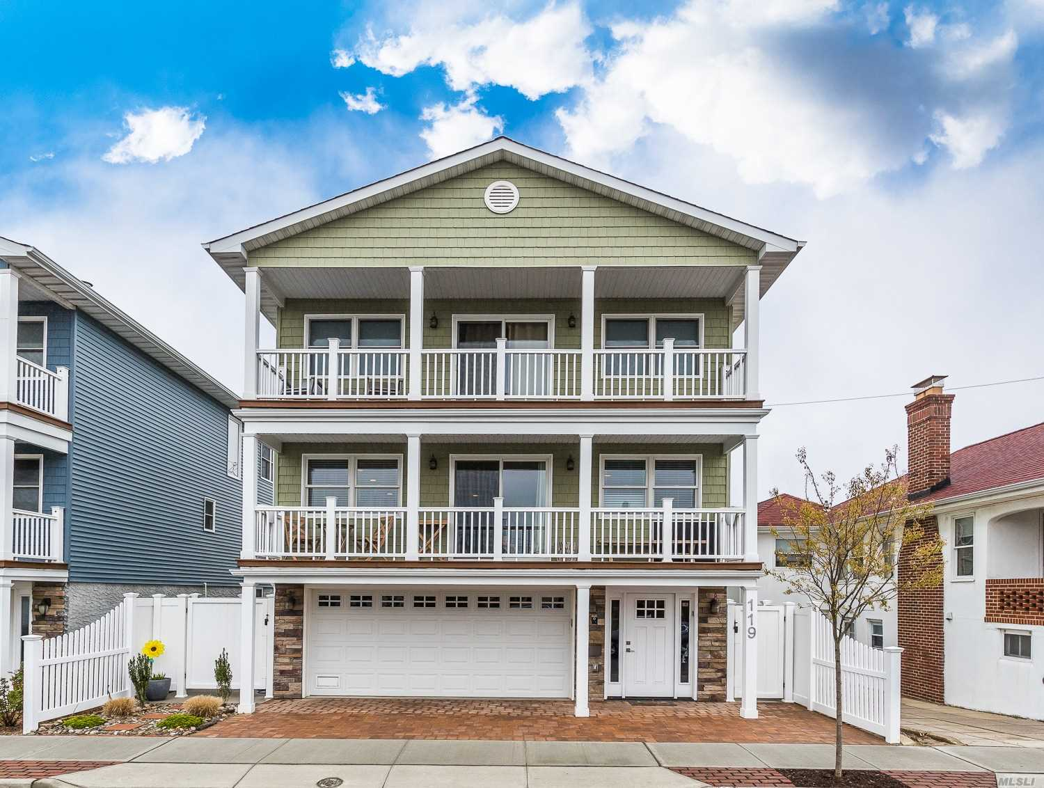Spectacular FEMA-compliant colonial built 4 yrs ago just 2 blocks from the beach/boardwalk & minutes from all schools and the best restaurants, shopping & entertainment Long Beach has to offer! Eastern exposure & ocean views from the 2 balconies (off family room & master). Featuring a spacious bright family rm, custom EIK w/ stone counters, gas range & ss appliances; large living & dining rm w/ gas fireplace, master suite w/ WIC & full bath; ground fl has 2 car gar; office & gym/play area.