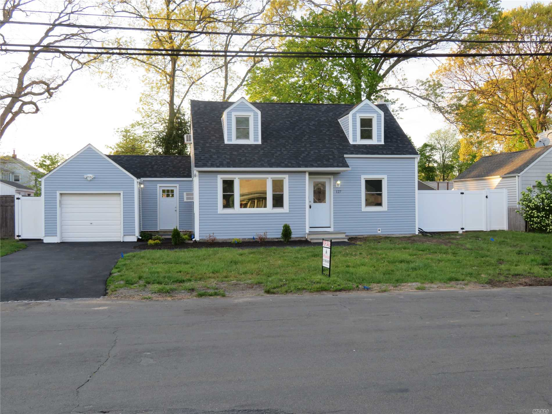 Like New, Totally Renovated, Expanded Cape with 4Br, 2 1/2 Bath, Everything New, Roof, Windows, Siding, New Kitchen with Bleach Oak Cabinets & Granite Counters,  Center Island in KIt, 3 New Ceramic Baths, Oak Floors Throughout, Ceramic Tile Basement, Formal DR, 3 A/C Units, Bluestone Entrance & 1 Car Garage, Fenced Yard. Too Much to List, A Must See!!