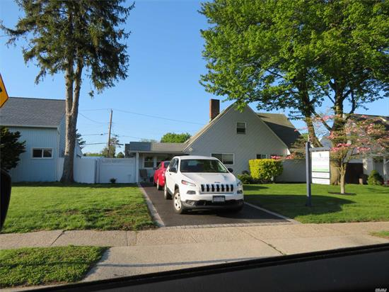 Move In Ready Expanded Ranch In Levittown! Updated Eat-In-Kitchen W/ Custom-Piped In Propane Cooking. Formal Dining Room. Living Rm/Den. 4 Bedrooms W/ Closets. 2 Full Baths. Crown Moldings. New Boiler. 150 Amp Elec. AG Tank. 2 Zone Heat. Private Driveway. Mstr Br 1st Floor. Laundry 2nd Floor. Plenty Of Storage W/ Eevees & Attic. Private Fenced In Backyard W/ Deck & Shed. 1366 SQFT. Low Taxes!!!!