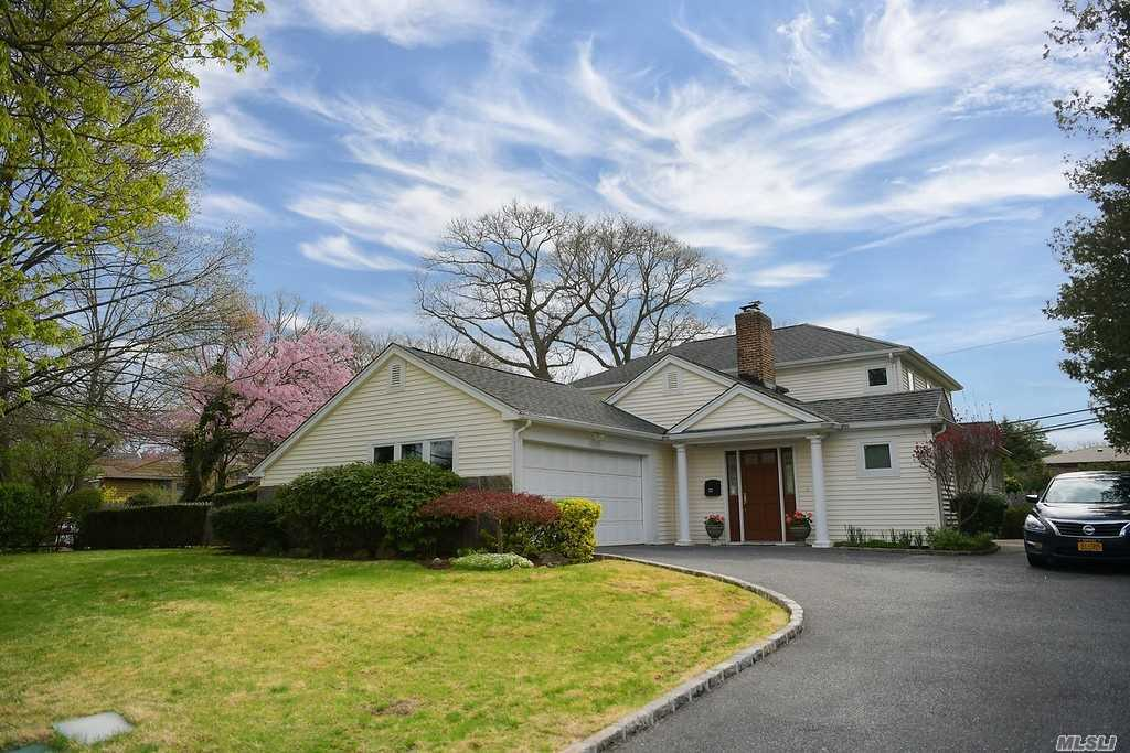 Rarely do you find a 4 BR, 3 Bath Colonial in Roslyn Country Club with LOW Taxes on 1/3 Acre that is Beautifully Renovated & Spacious. This golden Gem has a Master BR Suite on the 1st Fl,  Great Entertainment Flow w/ Dual Sided WBFPL, Large/Bright EIK, Sunny LR, DR & Den. Features Include Radiant Heat, CAC , IGS, proximity to Middle School in the Famed East Williston/Wheatley School District . A GOLDEN GREAT!