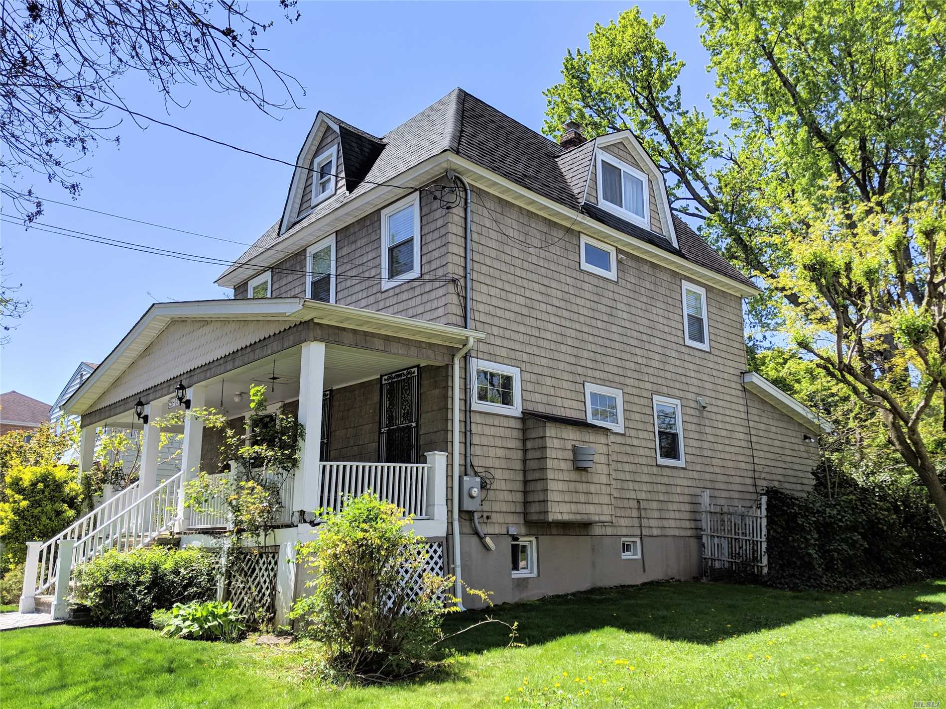 Spacious 4 bedrooms Dutch Colonial with 2 Car Garages in the heart of Bayside. Convenient location near Bell Blvd and minutes away from Bay Terrace Shopping Center - with supermarket, restaurants, movie theater, and etc. Bus Q13 to Flushing- Main St.