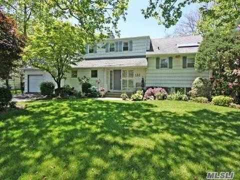 Elegant multi level split in park-like setting with oversized den with vaulted ceilings, CAC and much more.