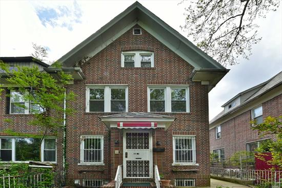 Spacious semi-detached single family brick home in Jackson Heights with potential to convert to 2 family. This 5 bedroom 3 bath home features large rooms, fully finished basement with separate outside entrance, 3 car parking, and front and back yards. Conveniently located just one block from Northern Blvd with easy access to shopping, town, buses and train stations.