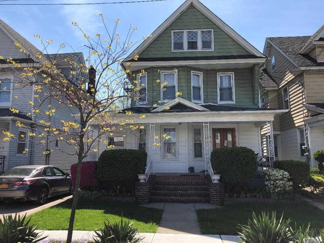 Richmond Hills Finest... Regal Three Family Victorian set on beautifully landscaped property. Full Garage w/Carport, Basement with Separate Entrance...A Must See!!