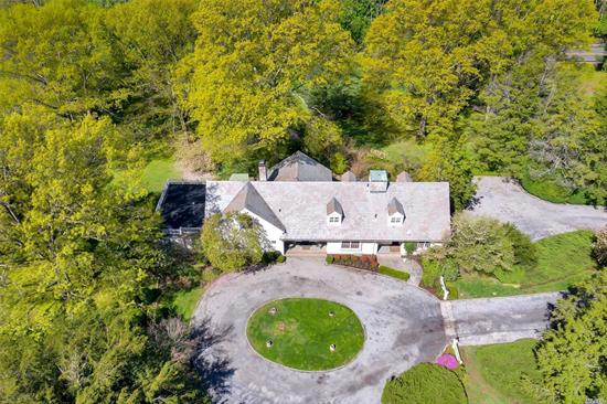Prime Gold Coast location in the heart of Mill Neck, New York. Beautiful pristine Farm Ranch sits proudly on 5 splendid acres with a fabulous first floor master bedroom suite. Wonderful home with spacious principle rooms, wood paneled library, living room with wood-burning fireplace, french doors to rear yard, bluestone patio and four car garage. Emerald lawns and majestic trees are the perfect back-drop for this gem only steps from Shu Swamp preserve and Beaver Lake where nature ignites you.
