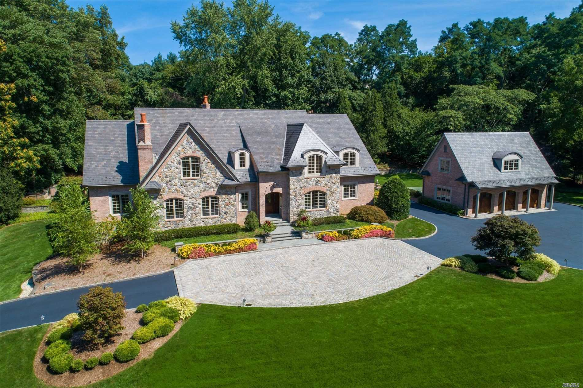 Spectacular Estate-Like Residence Built in 2004 Offers Quality Design And Fine Finishes. Enjoy Country Club Living In This Stunning 6 Bedroom 7.55 Bath Home. Grand 2-Story Entry, Spacious Floor Plan, 10' Ceilings, Mahogany Study, Formal Dining, Butlers Pantry, Gourmet Kitchen, Great Rm With Cathedral Ceiling, Living Rm With French Doors Lead To Covered Porch, Heated Pool, Outdoor Bth, Slate Roof, Copper Gutters, 3 Fireplaces, Radiant Heat, CVAC. Bonus Area Over Garage Beach/Mooring/Camp CSH SD#2