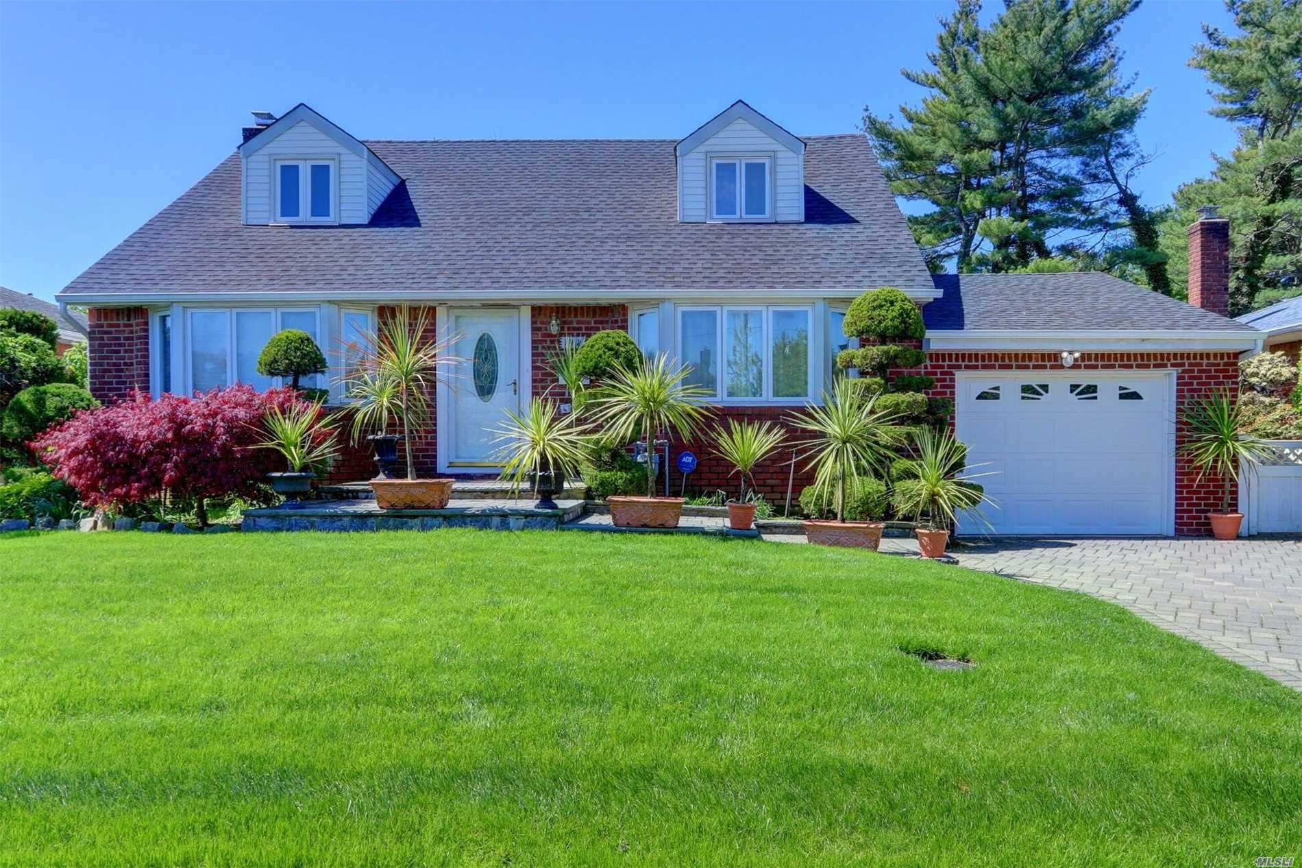 Immaculate expanded cape nestled on beautiful tree lined street, Large kitchen, living room, dining room, over-sized family room for entertaining, 4 bedrooms and 2 full bathrooms. Plus new roof . Make this your place to call HOME!