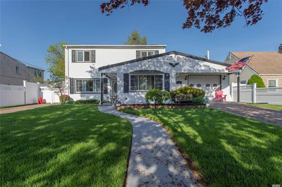 Beautifully Maintained Colonial Conveniently Located Close To Parkways And Shopping. New Roof, And Gutters, Updated Boiler And Siding. 2 Driveways, 1.5 garage, 5 zone Sprinklers, Generator, Skylights, Legal Accessory Apartment With Proper Permits.