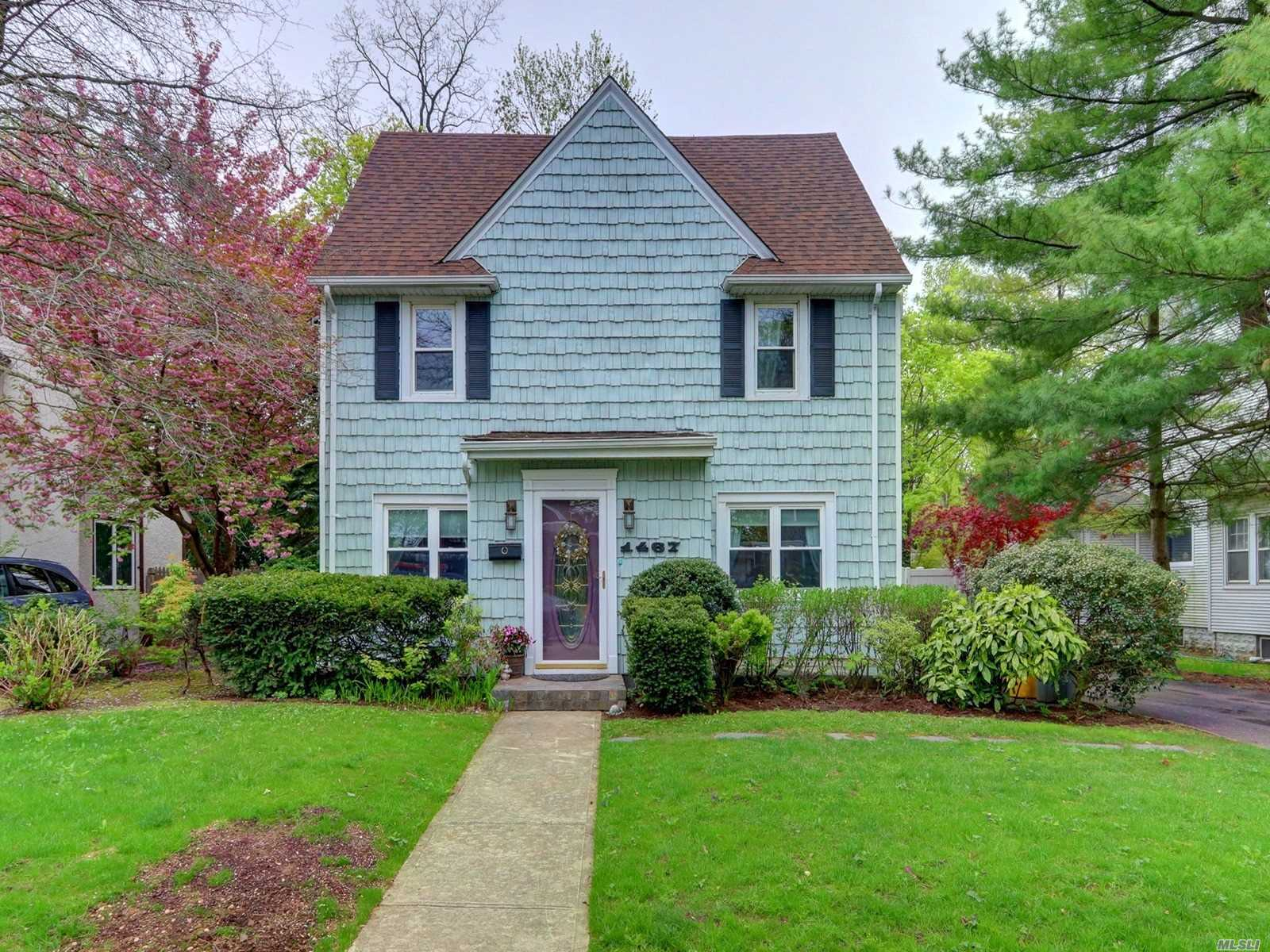 Bright and Beautiful 4 Bedroom Colonial in the desired SD of Hewlett-Woodmere! Walk Into this High Ceiling Spacious LR w/Fp, Formal Dining Area, Open Concept E.I.K, FB w/ Exit to Backyard and BSMT. Second Floor Boasts 3 LG. BDRMS w/FB plus 4th Lg. bedroom on 3rd FL. Finished Basement w/LR/Utly Open Space. Roof (2years New), Boiler Replaced 2018, Water Tank Replaced approx. 5 years ago, Most all Windows Replaced 8 yrs ago, Water Main Line Replaced Recently, Close to LIRR, Taxes Being Grieved!