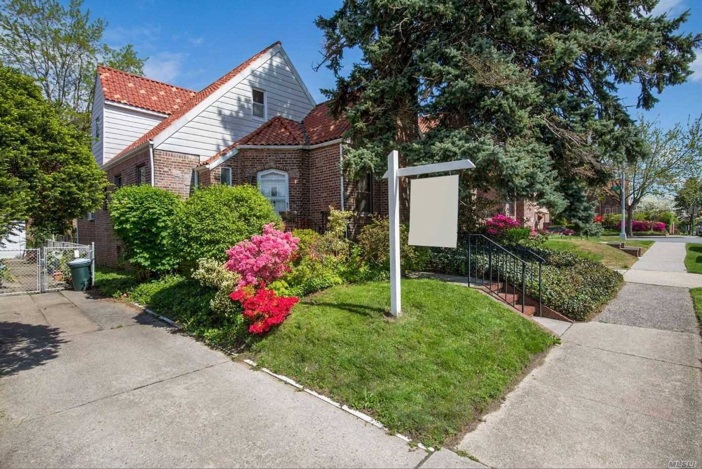 Welcome home to this brick tudor 1 family, vaulted celings and brick beams in lvingroom with firplace, large FDR, large kithen, master bedroom on 1st fl w/ add'l bedroom, 2nd fl-3 bdrms, 1 bath, large attic, full basement, 1.5 car garage, private yard. Home needs TLC.
