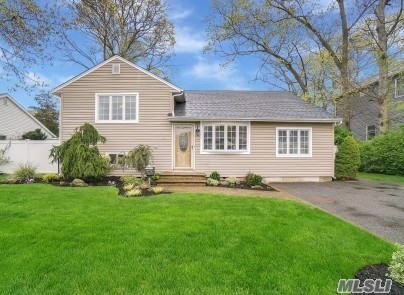 MASSAPEQUA WOODS NEWLY RENOVATED DIAMOND CONDITION, EIK W/CHERRY CABINETRY, GRANITE ISLAND, ALL S.S. APPLIANCES, GAS COOKING.OAK FLOORS THROUGHOUT. LARGE FORMAL DININGROOM. LARGE LIVINGROOM W/SPIRAL STAIRCASE TO LOFT/OFFICE/ 4TH BED. 2 DESIGNER BATHS, ONE W/JACUZZI, SHOWER AND MARBLE CHERRY VANITY. 2ND BATH W/VAULTED CEILING & GRANITE TOP CHERRY VANITY. MARBLE FLOOR. CROWN FLUTED MOLDINGS. 2 YR NEW ROOF, 2 YR PVC FENCING. UPDATED SIDING & WINDOWS. 200 AMP. PAVERS FRONT & REAR. JUST UNPACK!!