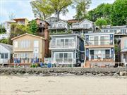 Fabulous Waterfront Beach Cottage in Beacon Hill Colony. Renovated to Perfection. Panoramic Water views.First Level Great Room L/R fireplace EIK Dining Area Bath Laundry Guest Room Deck, 2nd Level Master Bedroom Suite with Sitting Room Fplce Spa Bath Walk In Closet and Deck...Port Washington Train Line 35 Minutes to Manhattan Close to Restaurants and Shopping. Enjoy Beach Life!