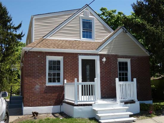 Stunning completely Renovated Bright Expanded Cape in Diamond Condition - 4 Bedrooms - 3 Full Bathrooms - Branded New Stainless Steel Appliances - Gleaming Hardwood Floors Throughout - Beautiful Full Finished Basement with Separate Entrance.