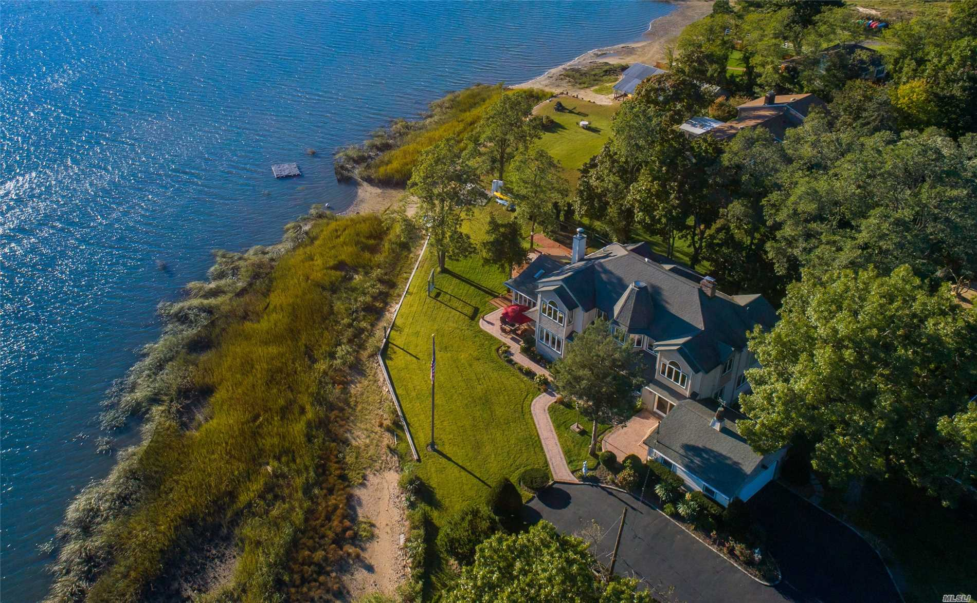 Views of the Harbor stretch endlessly from most every room. This amazing bay front property has large picture windows and doors that open to a soft grassy lawn overlooking picturesque Mill Neck. Warm wood finishes, lofty ceilings, a wood-burning fireplace and open spaces to gather and entertain lend charm and grace to this compound.