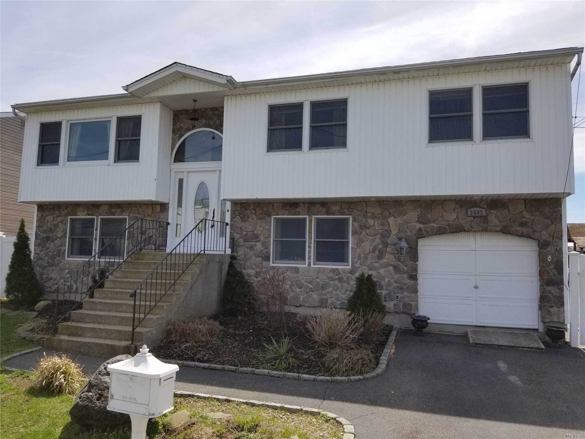 Beautiful 5 Bedroom 3 Bath Hi-Ranch Legal Mother/Daughter with Water views. New stainless appliances. Master en suite . 2 Story Deck with AG pool