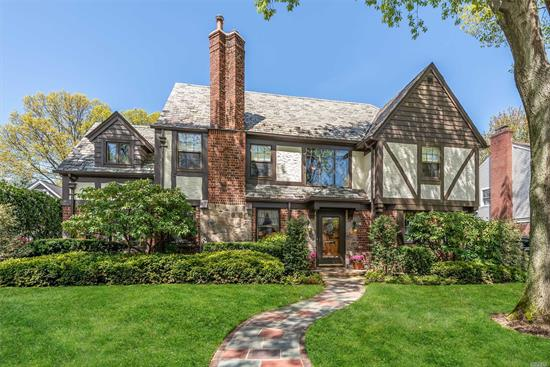Pristine Estates Tudor w/ bridal staircase and stained glass windows, Lg foyer, Lg Formal DR, Lg Formal LR w Fp., family room w/ stained glass windows, back patio off den, Lg Kit w/ breakfast nook and den, Full Bath. Fabulous for entertaining. Mstr BR w/ Full Bath, 3 addt'l bedrooms all spacious with many closets. Walk up Attic, CAC, IGS, Alarm, Gas heat, large paver patio, 2 car garage w/ storage. A MUST SEE!!