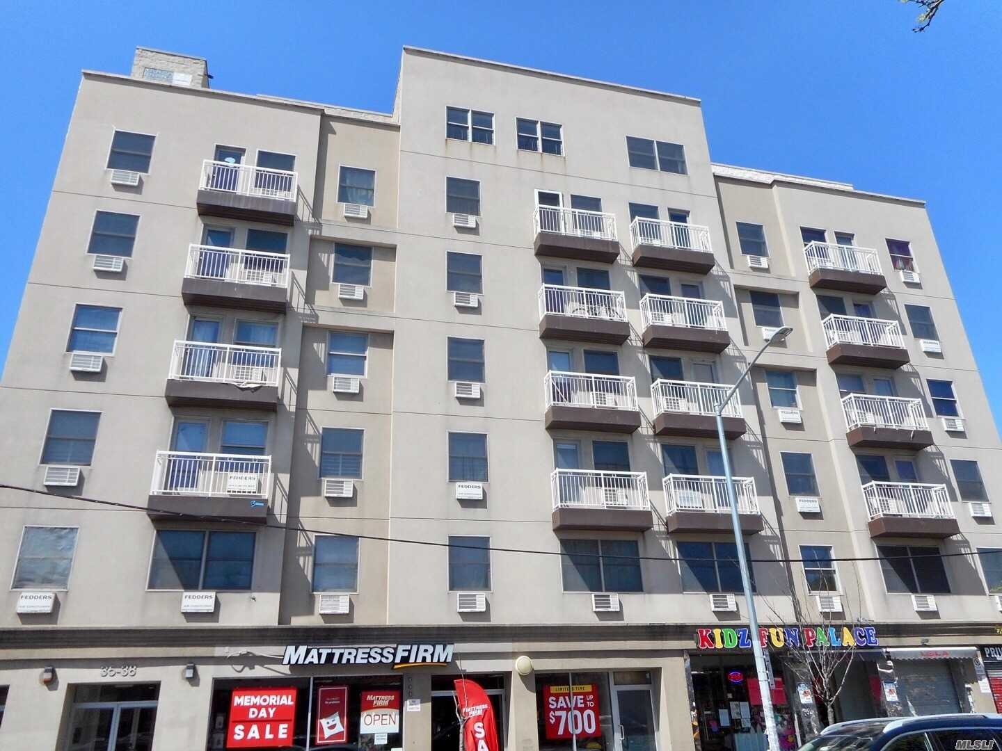 Large L shaped studio with balcony in Corona/ Elmhurst area . Updated kitchen and updated full bath. One block from main subway station, near business, restaurants. The is a newer condo building with 14 more years tax abatement, Real Estate tax only $642 a year now! Low common charge $244 per month including All except electricity. The condo also features free gym room and laundry room. Come see it before it's gone!