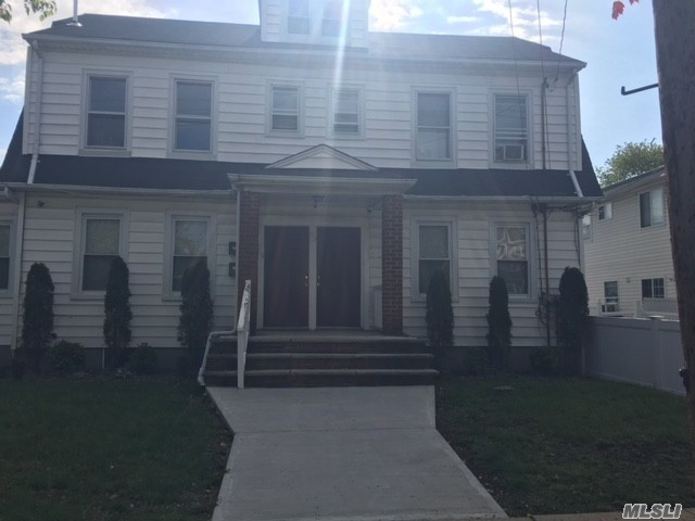 Legal 3 Family House With Great Curb Appeal. Walking Distance To Shopping, Transportation, Hofstra, NCC, Memorial Sloan Kettering Hospital. Huge Paved 10 Spot Parking Lot. Nice, Clean Apartments. Recently Updated Finished Basement.15 Camera Security System. Fenced yard. 2 Year Old Hot Water Tank. Coin Operated Washer/Dryer. All Leases Are Month To Month. Tenants pay utilities including heating. Nice, solid investment property with very low maintenance, great stable $7400 monthly income (10% cap)