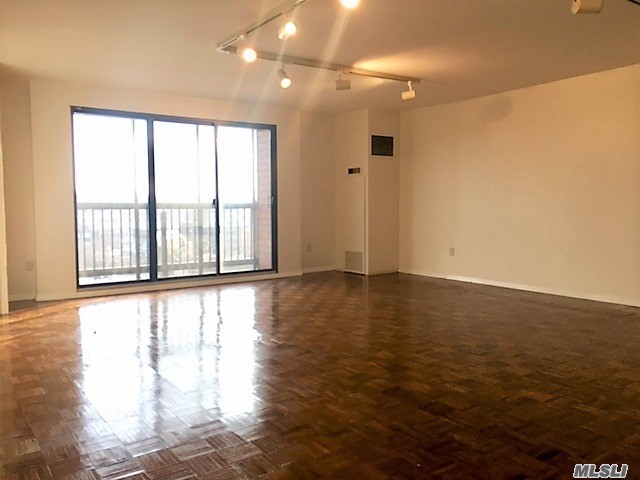 New Renovated Kitchen. Rare Over-Sized 2 Full Renovated Bedrooms + Dining Area, Eik, 2 Full Baths + 1 half bath. One Block From Lirr/Buses In Quiet Street In Heart Of Town. Fulltime Concierge/Doorman, Gym, 1 Indoor Parking included, Storage, Party Room. High Floor Unit W W/D in the unit, Sunny, Great Views, & Abundant Closet Space. Rarely Becomes Available. A Must See!