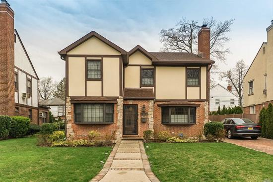 A classic style home that has all of today's creature comforts, this is the definition of this brick and stucco Tudor colonial! Situated in the heart of Hollis Hills, this stately home was expanded and completely rebuilt in 2007. Room after room of architectural details are complimented by only the finest accoutrements.