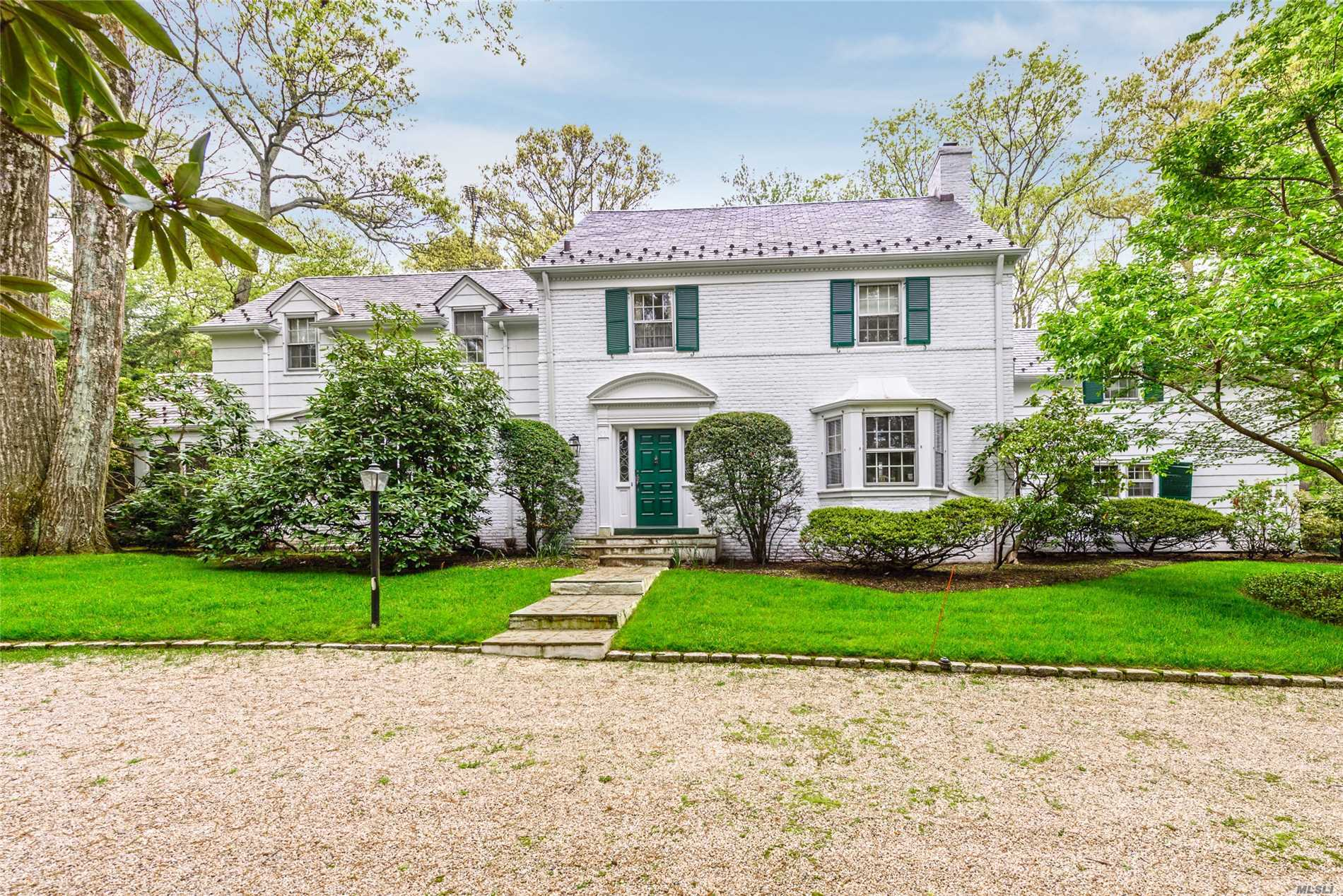 Brookville. Brookville Classic Slate-Roofed Center Hall Colonial. Circular Driveway leads to this 5 Bedroom, 4 Bath Home on a Prime 2.5 Acre lot with a Pool, 3-Car Garage, Front and Back Staircase, Hardwood Floors, 3 Fireplaces.