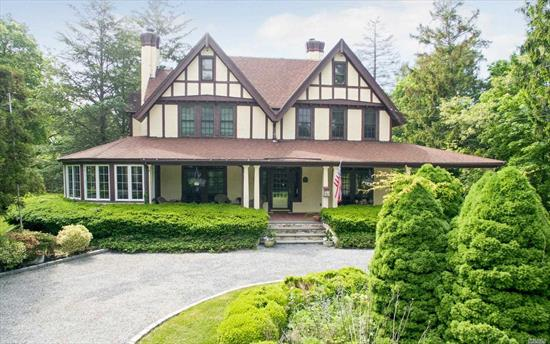 This Issac Green home built in 1902 exemplifies the essense of South Shore Living. Set on 1.87 acres this English tudor welcomes a bygone era. Coffered ceilings, French doors that open to the front porch, Foyer anchored by a wood paneled library, wainscoting, and a grand mahogany spindled staircase. The dining room is proportioned for opulent entertaining and orginal Tiffany glass windows reflect colors of every season. Landscape of gardens, Portico, fishponds,  perfect for grand scale living