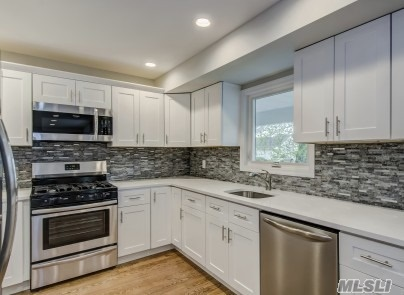 Newly Renovated With No Expense Spared. Colonial With Open Floor Plan. Custom Kit With White Shaker Cabinets, Quartz Counters & Stainless Steel App. 2 Custom Tiled Full Baths, New Wood Floors. 200 Amp Elec, Windows, Roof & Siding. New CAC, Finished basement
