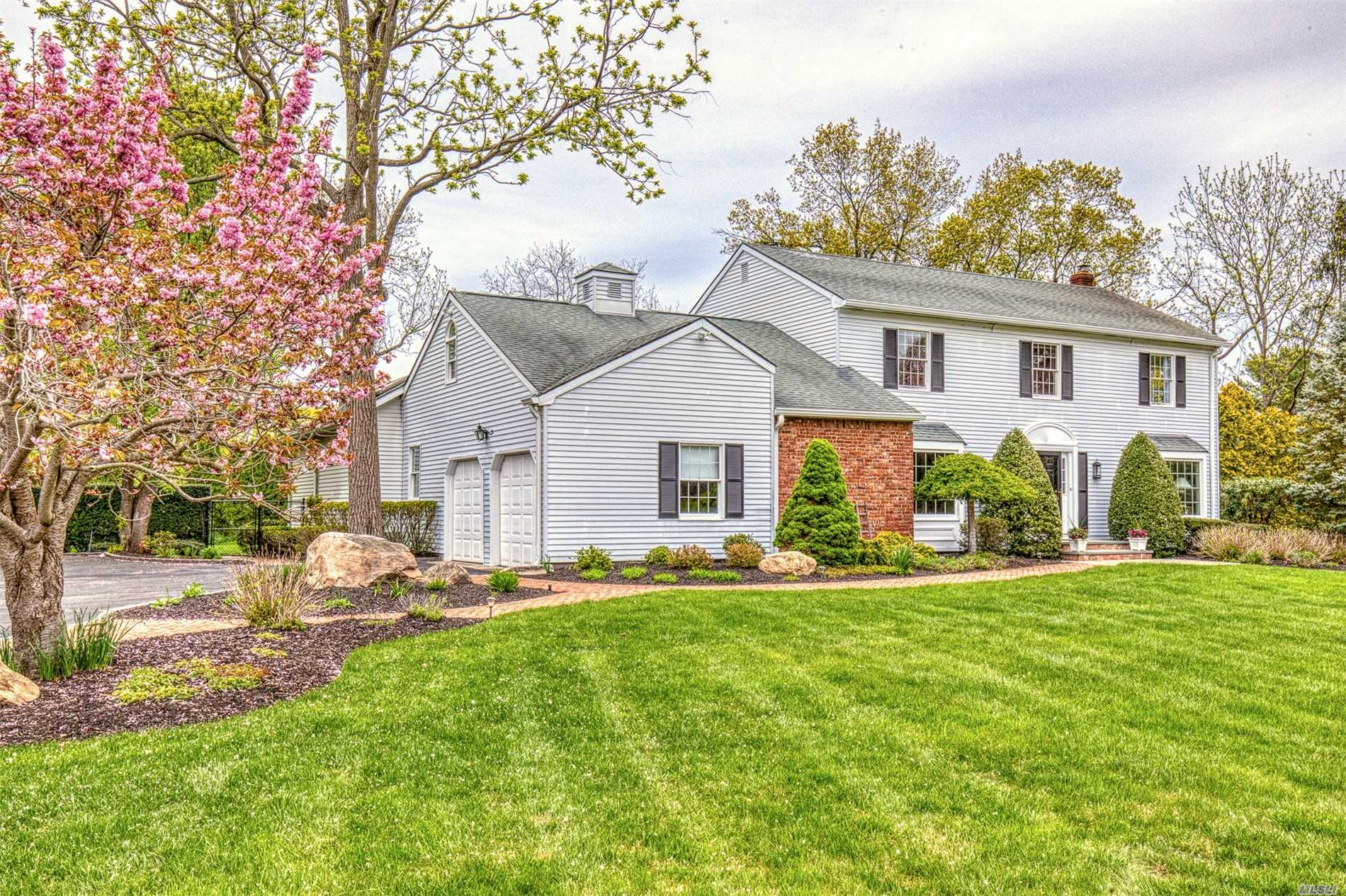 You will love living so close to the green in this beautiful & spacious Colonial in the sought-after Harbor Hills community of Port Jefferson. Enjoy beach walks, kyak, golf, tennis, fishing, dining - all within walking distance! After golfing the delightful 40x20 ig heated pool awaits you. Great for entertaining or exercising, you'll love this home's gentle elegance, with sprawling rooms & heartwarming decor. Renowned PJ Schools, Close to Hospitals & University. Move in and enjoy Life!