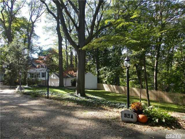 Peacefull Private Hideaway with Partial Waterviews down a winding country road off Cove road. Huge entry foyer, Open Spacious Great Room combo Living/Dining and Family room with fireplace. Large EIK with Pantry. Central Vac. Additional playroom/den. Main floor laundry.  Detached 2 car garage.  Short sale subject to 3rd party approval Great opportunity!!!