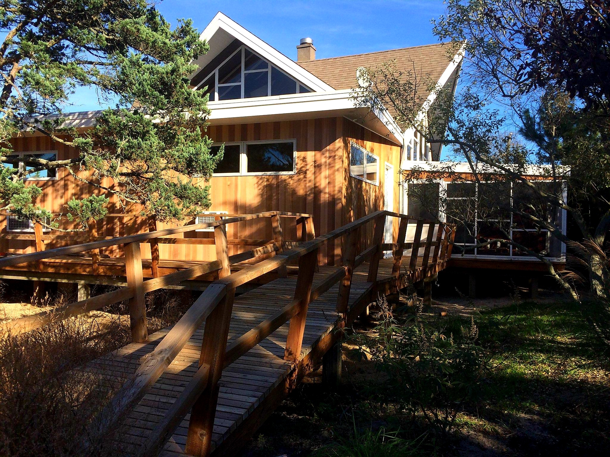 This house has all the space and amenities you need. With five bedrooms (king, 2 queens, 2 bunks), there's plenty of room for your family and guests. In addition to two full bathrooms, there's a delightful enclosed outdoor shower. Two ceiling fans plus air conditioners in every room keep the house cool at night. Kitchen was recently renovated. Large, furnished, front deck plus screened-in porch complete with picnic table. Just off the porch is a shed with a new washer and dryer and storage space for the bikes and beach chairs we'll provide. Plus outdoor grill, WiFi (FiOS), DISH TV, stereo including turntable for your vinyl records. <br> <br> The ocean, bay, tennis courts, basketball court, ball field, market and marina are just a few minutes away. Across the street, you'll find a bay beach, pool, and playground for the kids. The restaurants, shops, and theater are only ten minutes away by bike.