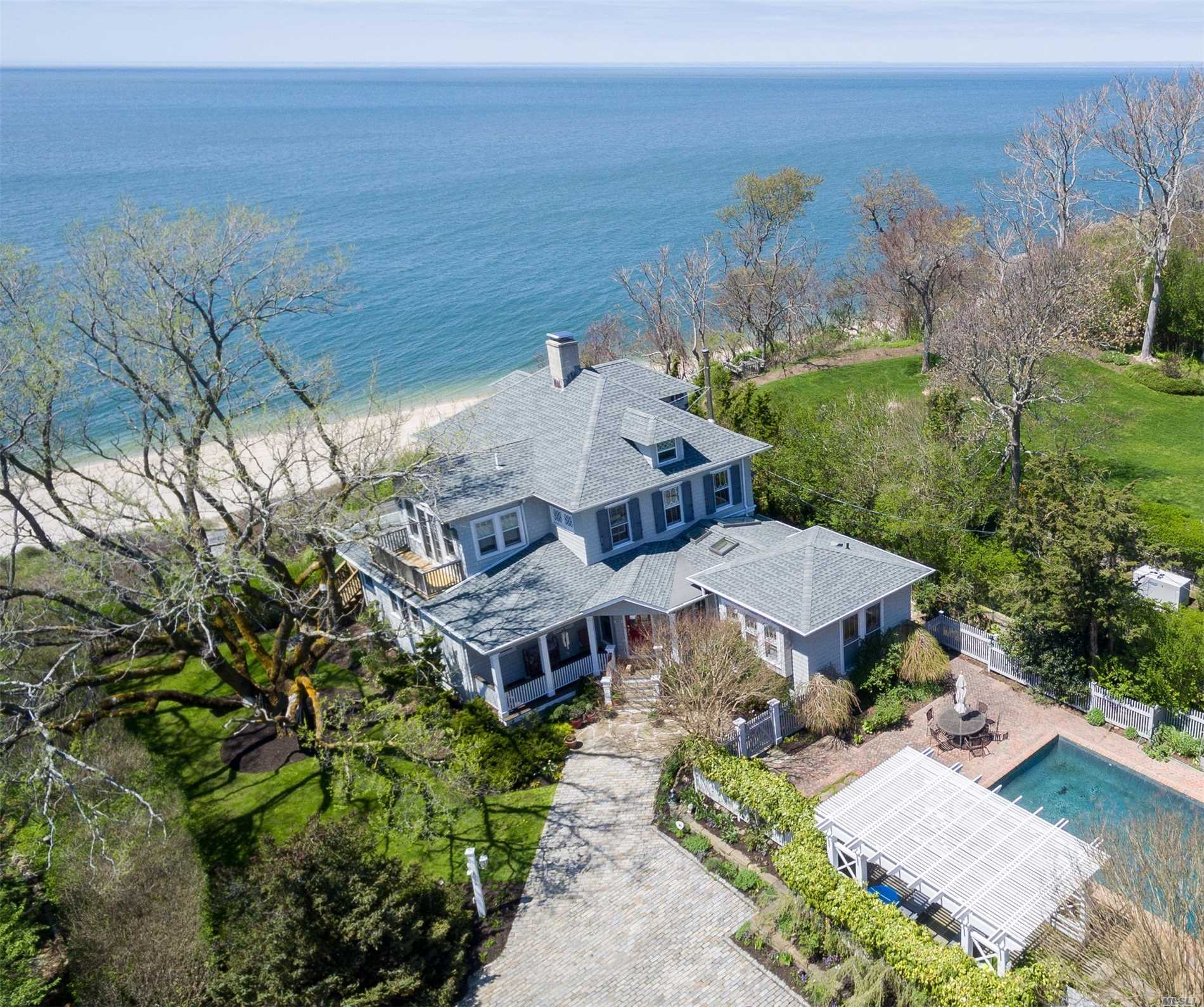 Exquisitely restored mint antique home overlooking LI Sound. Panoramic water views from many rooms, waterside patio, waterside deck, 2nd floor waterside balcony. Large eat-in gourmet kitchen, wood burning fireplace, 2 gas stoves, CAC, updated appliances. Private access to beach, heated gunite pool with pergola covered patio & hot tub. Original leaded glass cabinets and feaures.
