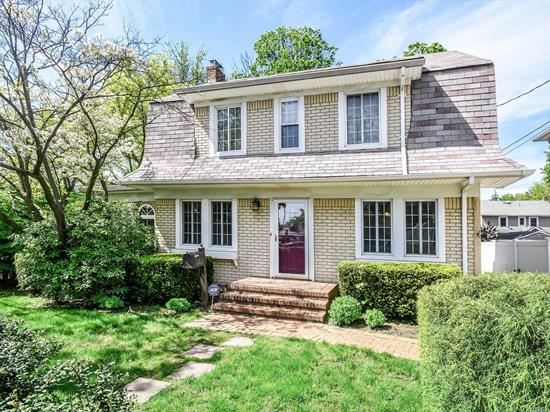 Southern Exp, Sun Filled Charming Colonial W/Gleaming Hardwood Floors. 1st Flr, LR w/Cast Iron Wood Burning Stove. FDR, Fam Rm, Eat In Modern Kitchen w/1/2 Bath & Sliding Doors To Deck. 3 Bedrooms, Full Bath. Large, Deep Fenced in Yard. Full Basement . Close To Town, Train & School.