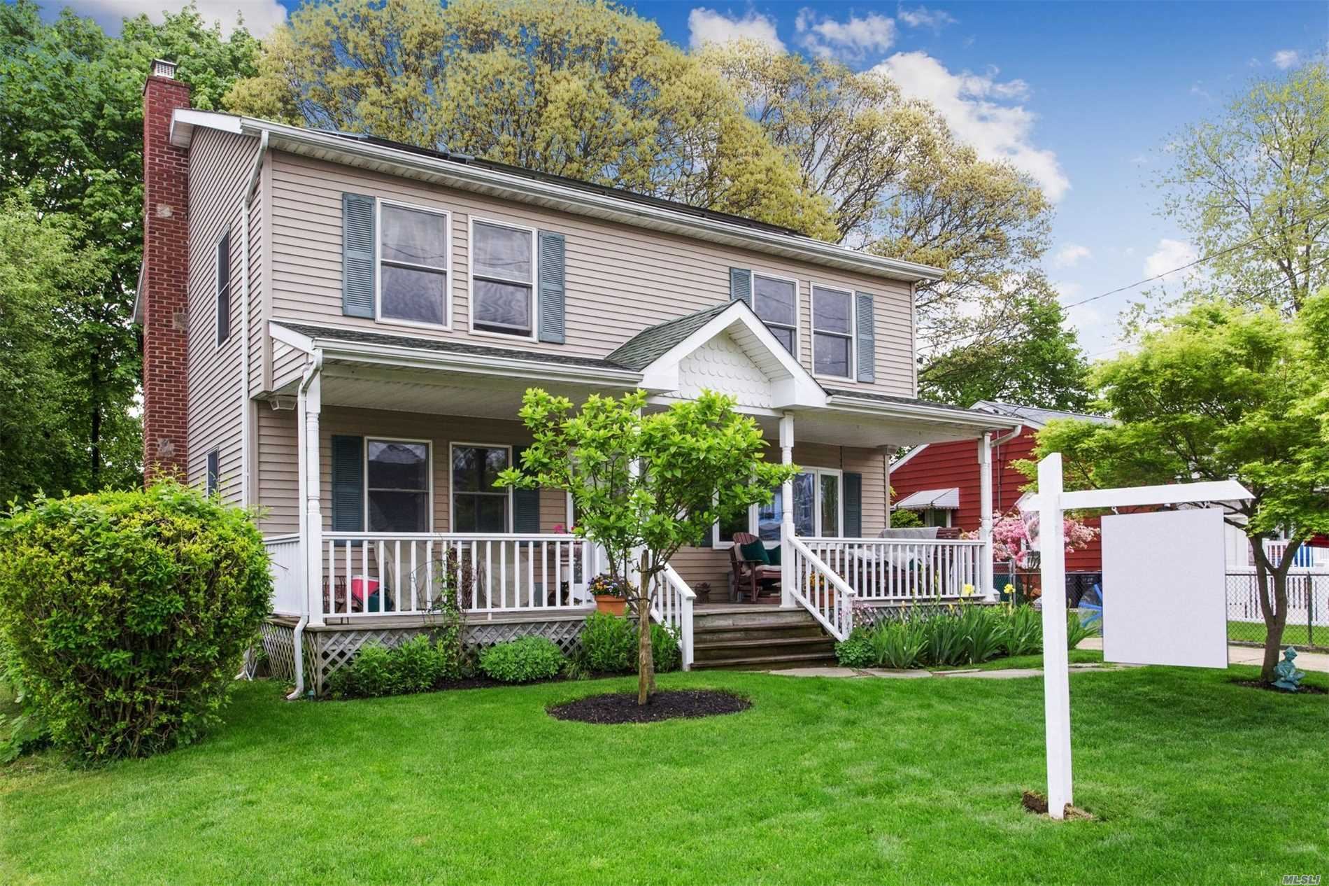 Beautifully maintained, spacious colonial w/park like grounds, cac, energy saving solar panels, lovely front porch, oversized dining and living rooms, 4 nice sized bedrooms, partially finished basement, approximately 1 mile to train station.