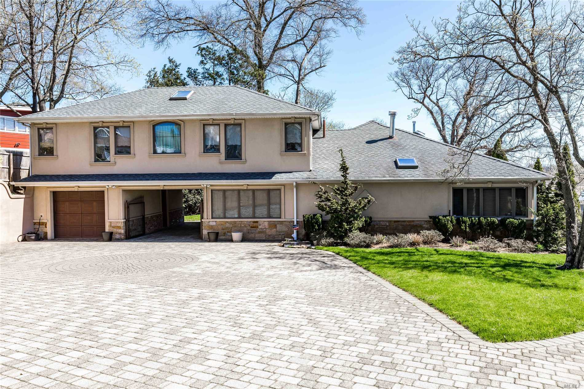Pristine Bayside Home with Water Views Renovated to Perfection! Grand Entry Foyer, Spacious Living Room With Large, Stone Wood Burning Fireplace, French Doors Open to Over-Sized Formal Dining Room, Custom Gourmet Eat-In Kitchen with Top of the Line Stainless Steel Appliances, Water Views Throughout, 2 Master Bedrooms With En Suite Jacuzzi Baths. Alarm System With Cameras, Andersen Windows, Large Backyard with Large Salt Water Heated Pool. This Home Is a True Gem And A Must See!