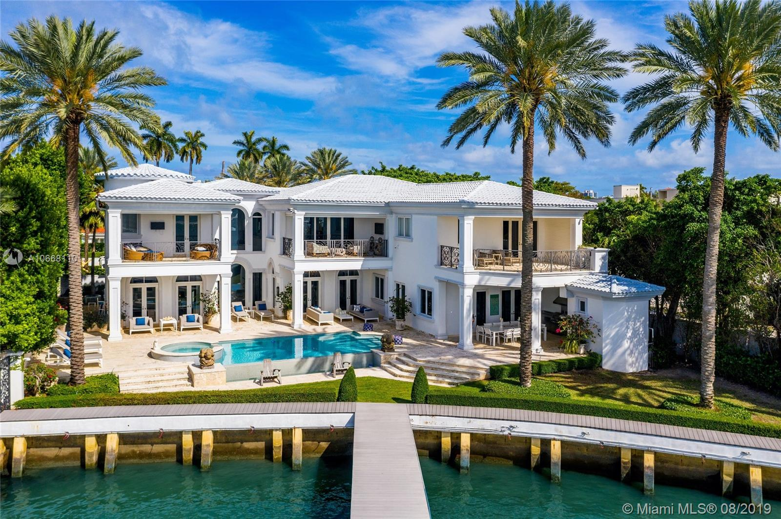 Situated On The Most Sought After Street In Miami Beach, This Completely Redesigned North Bay Road Masterpiece Offers The Quintessential Miami Lifestyle At An Unbeatable Value. Tucked Behind Private Gates On A Prime 19, 200 Sf Lot, This 6 Bd+ Office / 7.5 Ba Fully Automated Smart Home Boasts 10, 070 Total Sf Of Bespoke Interiors W/ 133 Ft Of Open Bay & Downtown Sunset Views. Enjoy Large Sun Filled Rooms W/ High Ceilings & Open Bay Views Throughout The Meticulously Designed Layout Which Is Ideal For Family Living Or Lavish Entertainment. The Backyard Is An Entertainers Paradise As It Features Covered Loggias, Summer Kitchen & Bbq, Infinity Edge Pool W/ Spa, Cabana Bath, Downtown Sunset Views & 133 Feet Of Prime Open Bay Which Can Accommodate An Oversized Yacht. Priced Below Replacement Cost