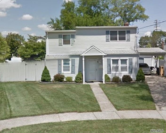 Legal 2 Family by Permit. (Owner Occupied).Close to LIRR.This Home Nestled in a Beautiful Cul de sac. Offers Comfortable Living Space For All. 1st Floor: Kitchen, Dinning Room, Living Room, Full Bath, Laundry, Sunroom. 2nd Floor: Eat in Kitchen, Laundry, Living room, Full Bath 2 Bedrooms.