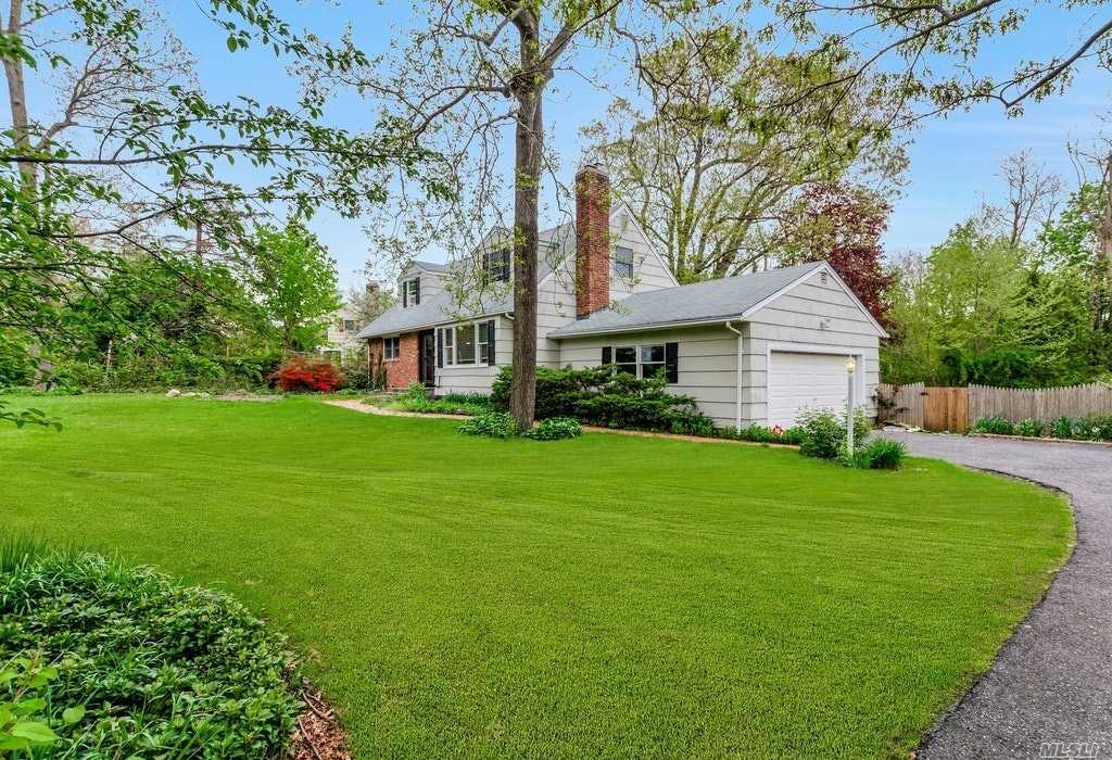 This Home Boasts Gleaming Hardwood Floors Throughout, Updated Eat-In-Kitchen w/Granite Counters & Stainless Appliances, Formal Living Room w/Wood Burning Fireplace, Formal Dining Room, 5 Bedrooms, (5th BR Can Be Used As a 1st Floor Master Bedroom, Guest Room, Den or Study). Quiet, Private Yard w/Heated In Ground Pool, 2 Car Side Load Garage, 200 AMP Service. Taxes Are Being Grieved. Close to LIRR, Stony Brook University & Hospital, Stony Brook Village.