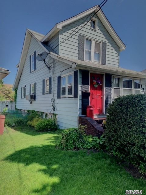 Charming 3 Bedroom 2 Bath Colonial On DOUBLE LOT.(Possible Sub Division) Investment Potential Or Renovate To Make It Your Own! Gas Heat And Cooking , Sewers, Short Stroll to LIRR, Parks , Town Pool, Library. A Must See!