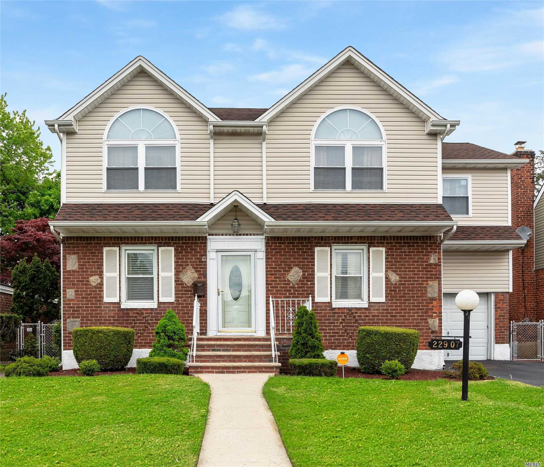 This charming XL 2-family property w/park-like grounds, nestled in the heart of Queens, MUST BE SEEN. It has Hardwoods throughout,  2 Kitchens, 2 LR/ DR Combos, 4 Bds, 3 Fbths, , jetted tubs, 2 walk-in Closets, 2nd fl. vaulted ceiling & Skylight, surround sound, finished Basement w/OSE, attached garage w/electronic opener and close to all forms of transportation. The unlimited other amenities, combined w/the unlimited new memories that can be made in this HOME, is REMARKABLE!